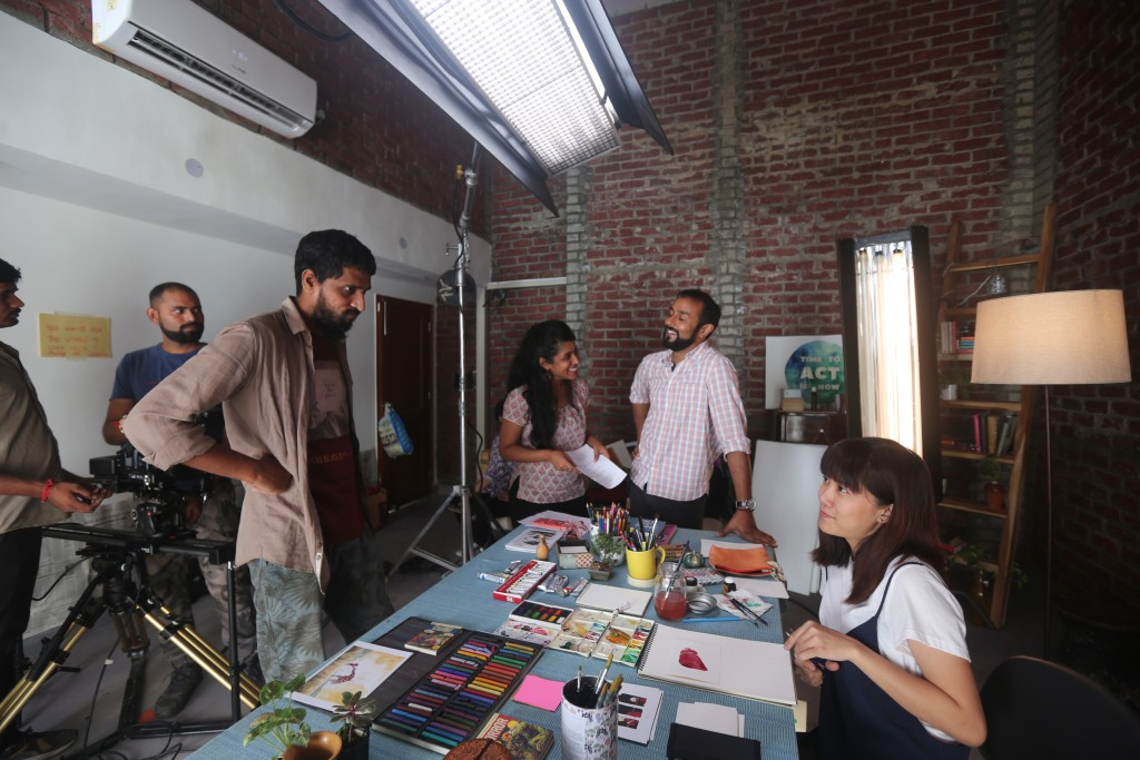 On the sets of the WHO project with Indonesian artist Grace Djiauw and longtime collaborator cameraman Karan Thapliyal (left)